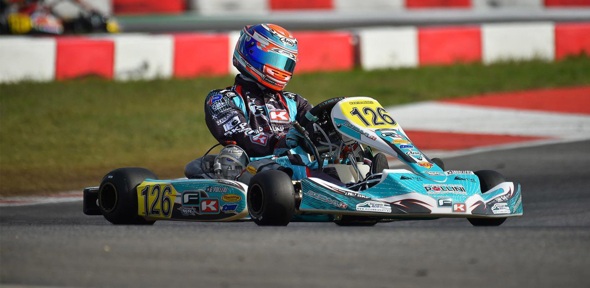 Pollini on the winners podium of the WSK Open Cup in Lonato